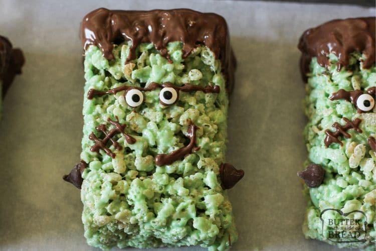 Frankenstein Rice Krispie Treats are cute green Krispie treats dipped in chocolate & made into Frankensteins! Simple Halloween rice Krispie treats perfect for Halloween Parties!