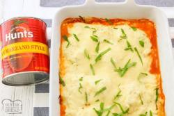 Cheesy Baked Ravioli Lasagna made with San Marzano tomatoes, 3 types of cheese, Italian Sausage and frozen ravioli. Easy weeknight baked ravioli recipe full of flavor!