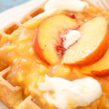 Peaches and Cream Waffles made with a crispy Belgian waffle recipe topped with a simple homemade chunky peach syrup and sweet cream. Perfect waffle recipe for special occasions and brunch!