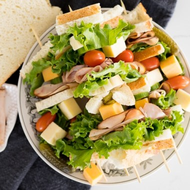 Appetizer Skewers are such a fun and easy way to serve various types of foods. Putting your sandwich onto a skewer, you are able to pack a little bit of everything you like all onto the stick. Bread, lettuce, deli meat, cheese, veggies, you name it!