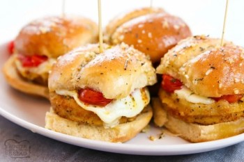Chicken Parmesan Sliders made in under 30 minutes and perfect for game day! Simple & flavorful Chicken Parm recipe made into easy appetizers.