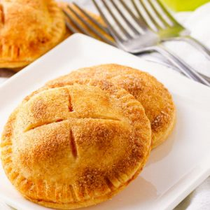 Mini Apple Pies are a simple 4 ingredient dessert made with flaky pie crust & apple pie filling. Lovely tastes of apple pie only so much easier to make! Perfect for making ahead and taking along to parties and family get togethers.