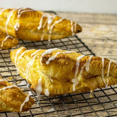 Easy Apple Turnovers made with puff pastry & apple pie filling for a simple, delicious apple dessert. Puff Pastry Apple Turnover Recipe is made in minutes & topped with a delicious almond glaze.