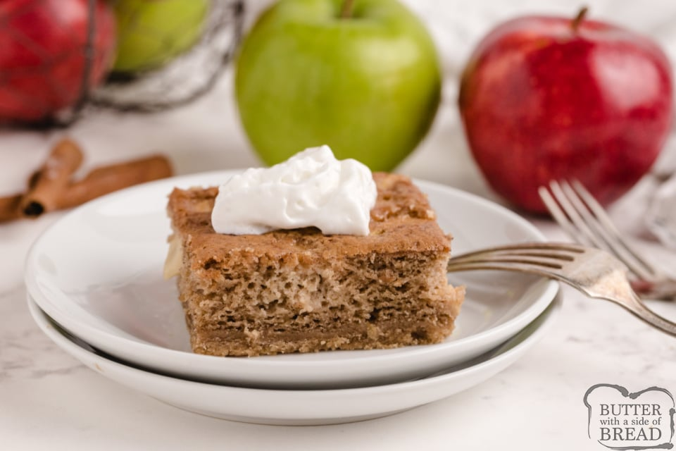 Sour Cream Apple Pie Bars with whipped cream on top