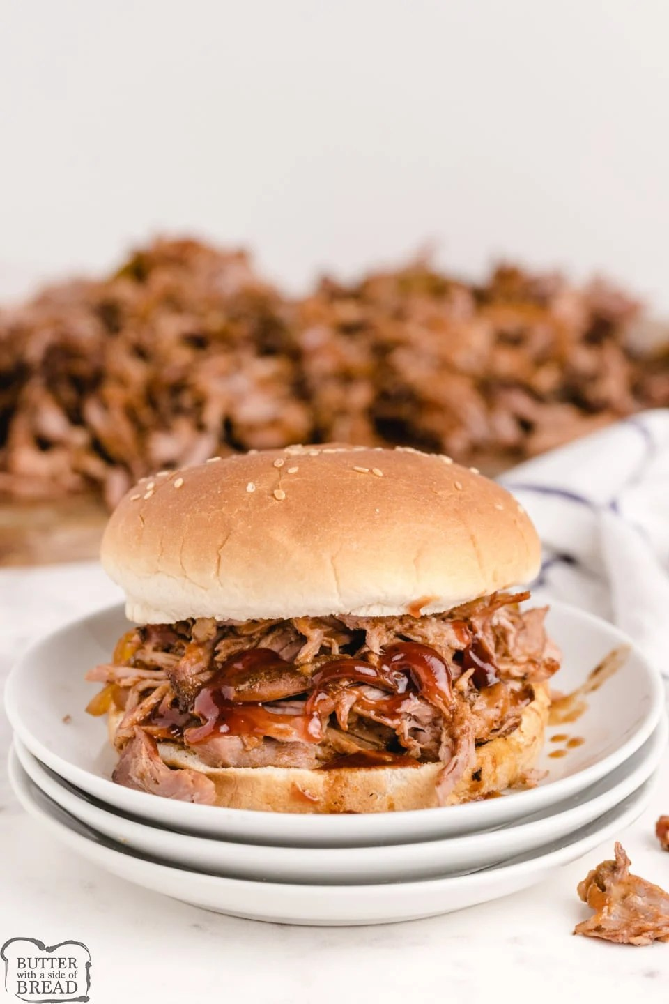 Slow Cooker BBQ Pulled Pork is moist, tender and packed with flavor. This simple crockpot pulled pork recipe is perfect for sandwiches, or even just served over rice.