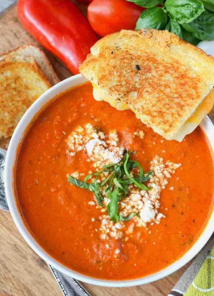 roasted tomato garlic soup with a grilled cheese on the side