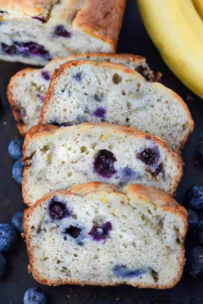 Banana Blueberry cream cheese bread on a cutting board scliced