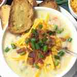 loaded potato soup with toasted bread crackers