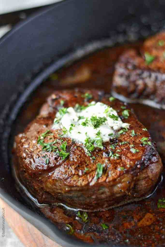Filet Mignon with Garlic herb butter in a skillet