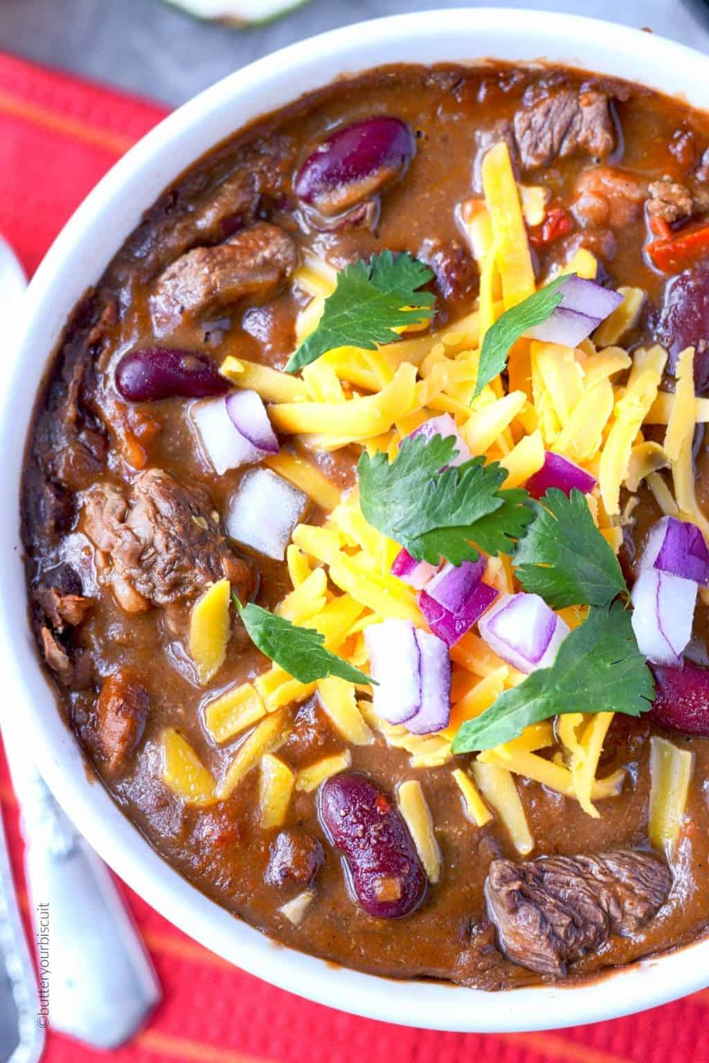 Ribeye steak chili in a white bowl