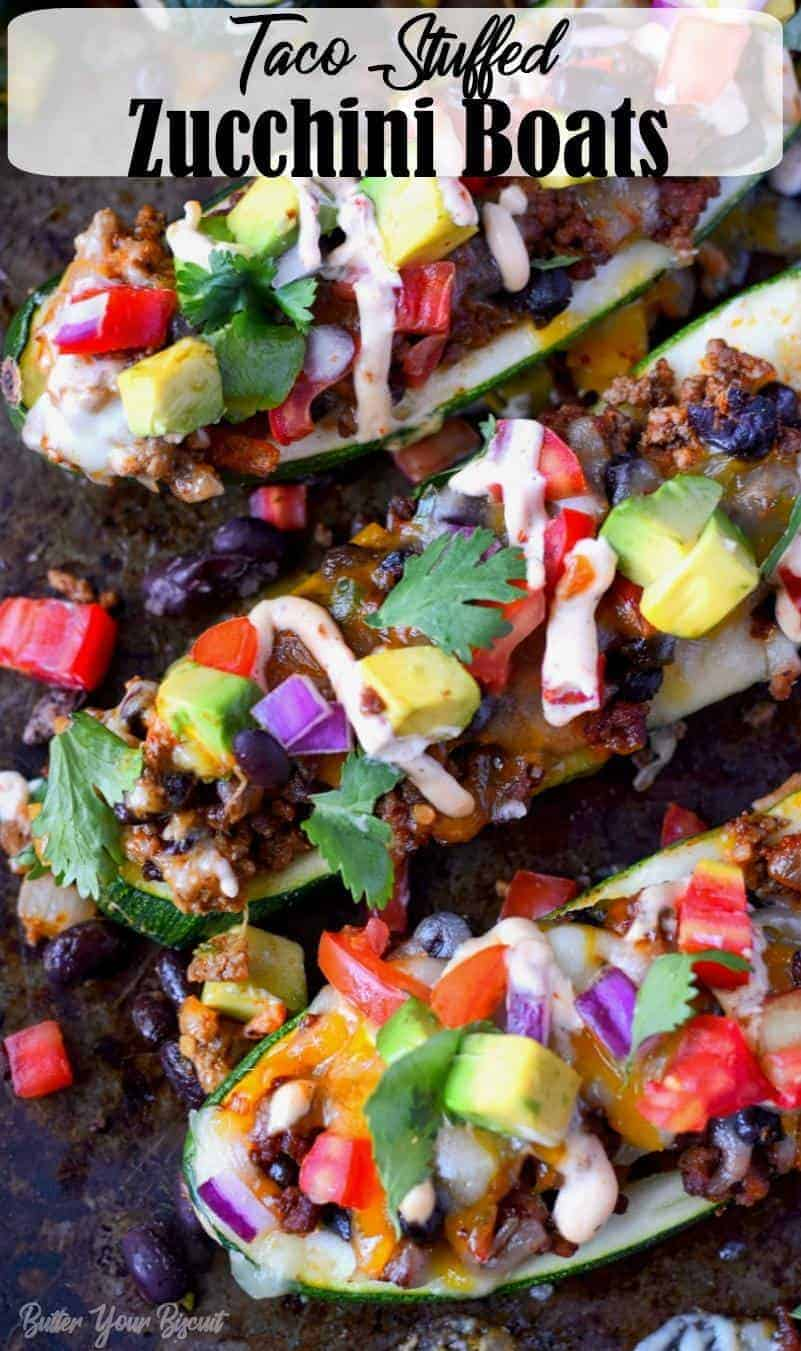 Delicious taco stuffed zucchini boats are loaded with cheesy ground beef. Topped with all your favorite taco toppings. Perfect any night of the week! #zucchini #stuffedzucchini #zucchiniboats