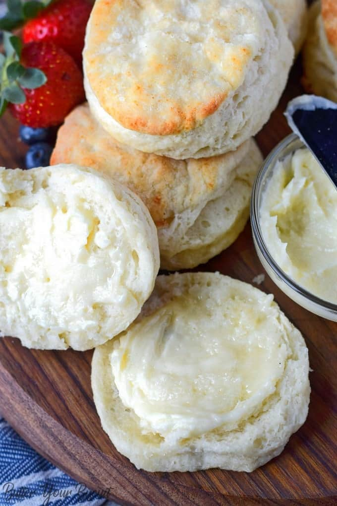 buttermilk biscuits with on sliced and honey butter