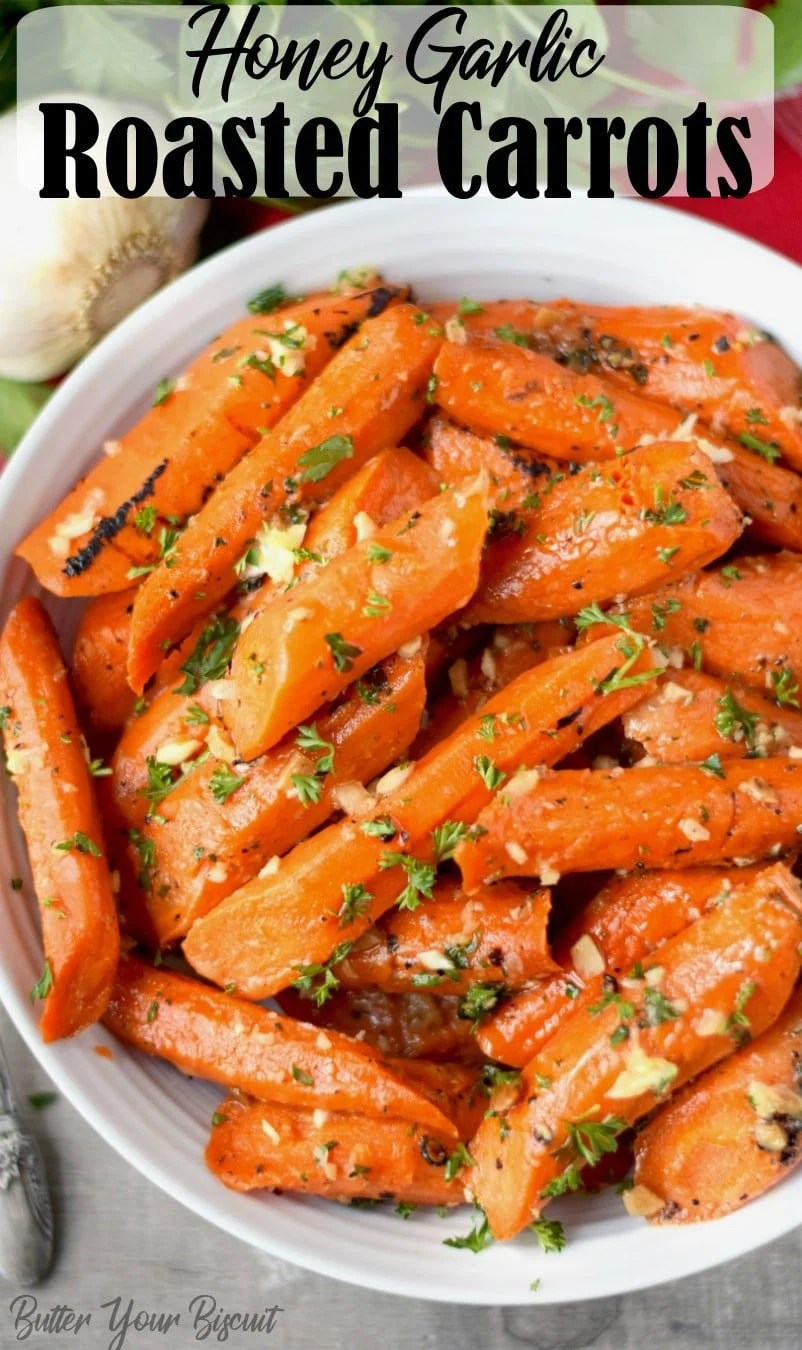 Honey garlic roasted carrots are incredibly easy and delicious. Perfect for a gorgeous Holiday dinner or weeknight supper. #roastedcarrots #sidedish #honeygarliccarrots