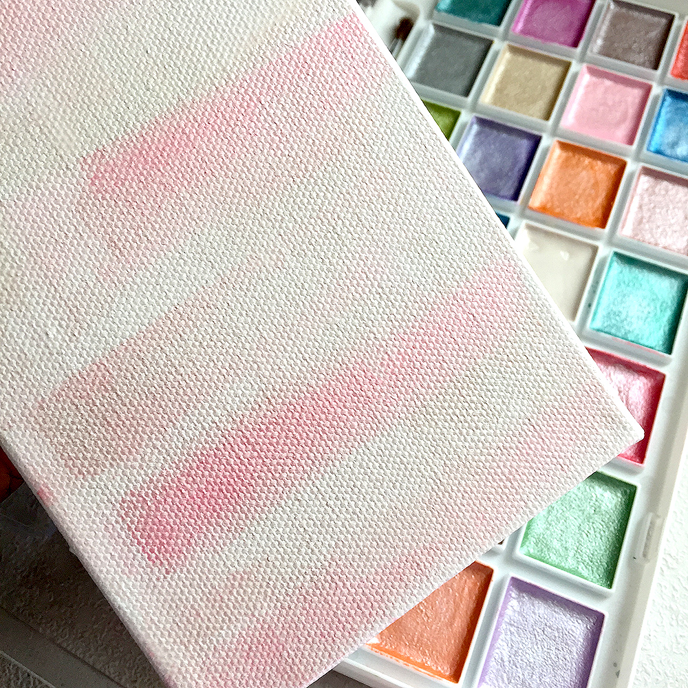 Begin Your Pink Christmas Tree Decor By Painting The Canvas Background. I  Am Using Pale Pink And Pearl White Watercolors On My Canvas.