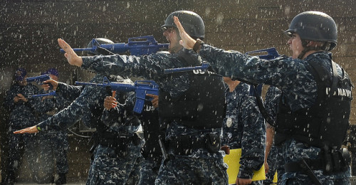 """Sailors practice security maneuvers in the rain"" image by Flickr user Official U.S. Navy Page"
