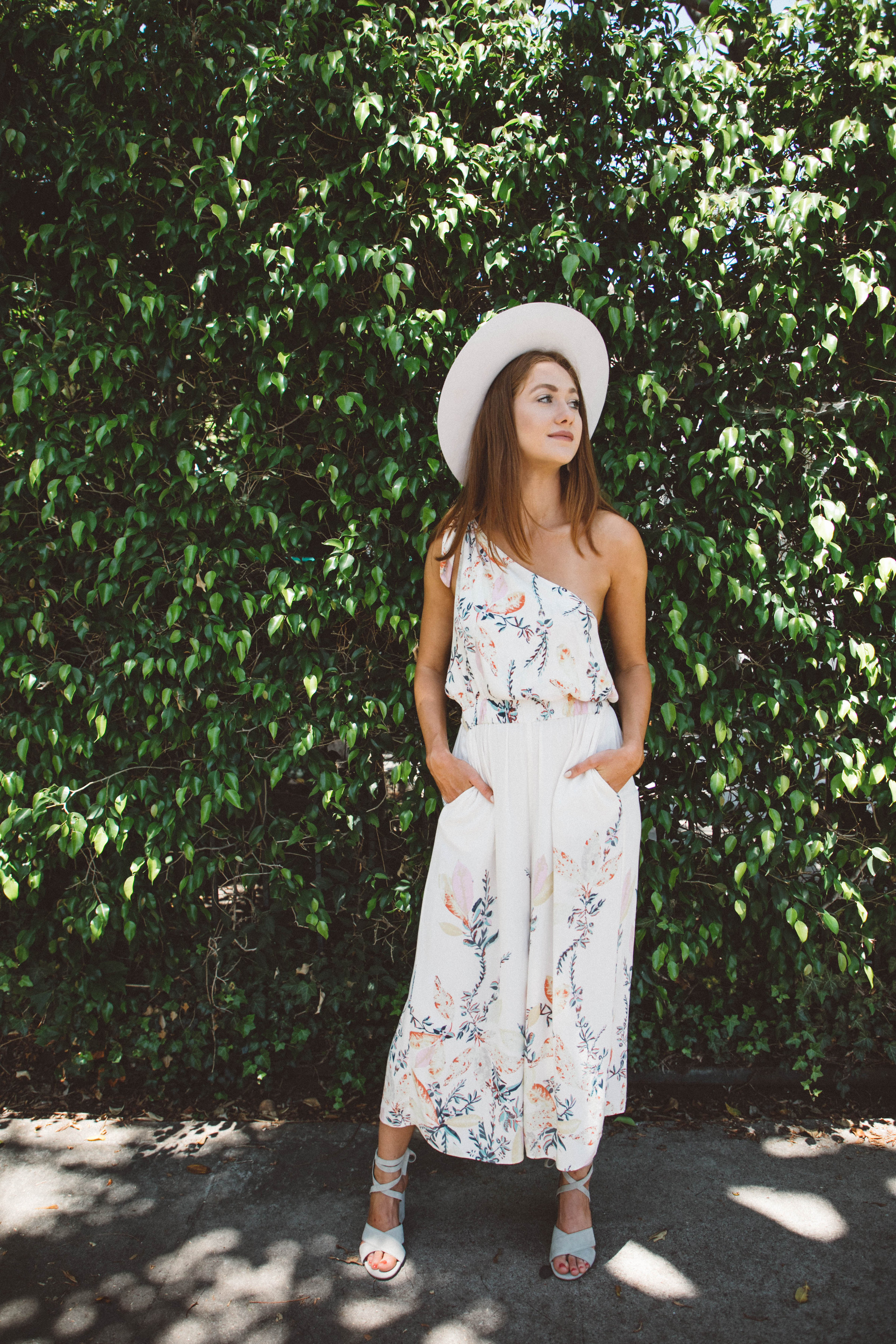 a770ad78478c five wedding outfit ideas that are not dresses - free people floral  jumpsuit -