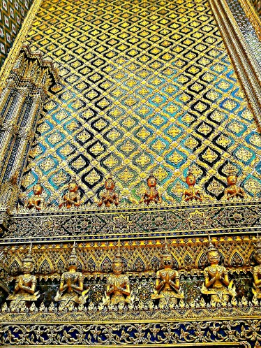 intricate details of one edifice at the Grand Palace in Bangkok, Thailand