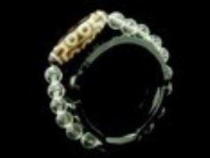 10 Eyed Dzi with Faceted 8mm Clear Quartz Bracelet