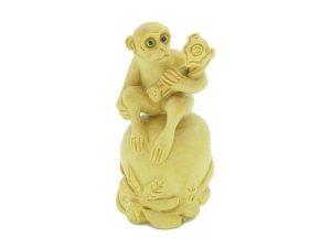 Auspicious Monkey Sitting On Peach And Holding Ruyi1