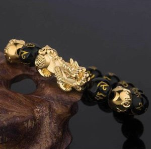 This Bracelet is made of 18K Gold plated Pixiu, authentic black obsidian, and OM symbol beads arranged in the count of 8 beads.