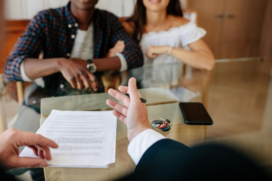 couple signing lease contract
