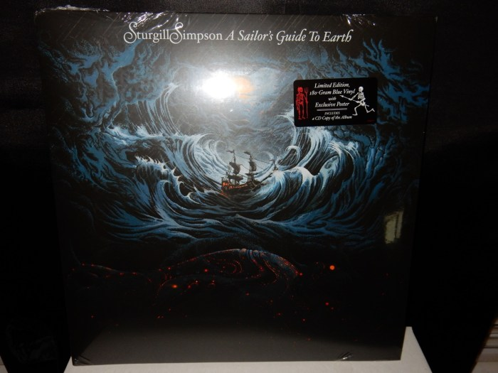 """180 gram vinyl LP pressing including bonus CD edition. 2016 release, the third album from the country singer/songwriter. Produced by Simpson, A Sailor's Guide To Earth was written-beginning to end-as a letter to his first child who arrived during the summer of 2014 and features eight original songs as well as a rendition of Nirvana's """"In Bloom."""" Recorded primarily at Nashville's The Butcher Shoppe, Simpson was joined in the studio by Grammy Award-winning engineer David Ferguson (Johnny Cash, John Prine, """"Cowboy"""" Jack Clement) and assistant engineer Sean Sullivan. Along with members of his touring band, the album features Dave Roe on bass, Dan Dugmore on steel guitar, Dougie Wilkinson on bagpipes, Garo Yellin and Arthur Cook on cello, Jonathan Dinklage and Whitney LaGrange on violin and special guests The Dap-Kings. A Sailor's Guide To Earth follows his break-through, Grammy-nominated 2014 release, Metamodern Sounds In Country Music. Beloved by critics and fans, the record was featured on year-end """"best of"""" lists at The New York Times, Rolling Stone, the Village Voices' Pazz and Jop, Rolling Stone Country, NPR Music, American Songwriter, Stereogum, the Los Angeles Times, KCRW, Pitchfork, The Washington Post and many others."""