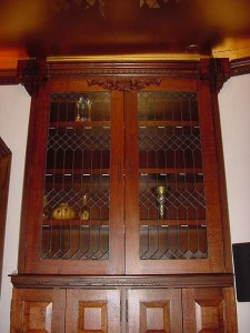 Gorgeous dark wood & leaded glass fronts. BYOB!