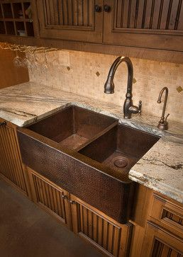 This copper farmhouse sink is certainly a showstopper! (It's very pricey though, but I bet there is a cheaper alternative somewhere.) What a cool look, though. Can you imagine the patina as it ages? Love! Sinks by Native Trails