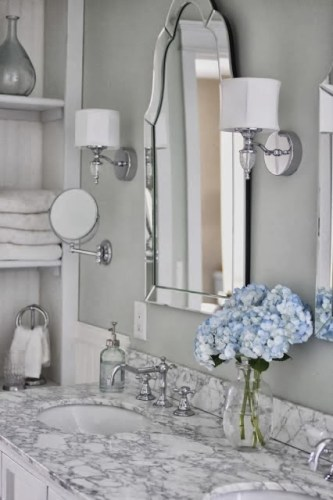 The devil is in the details and this mirror adds such a glamorous effect! Much better than a plain old mirror sheet. Image via Golden Boys & Me