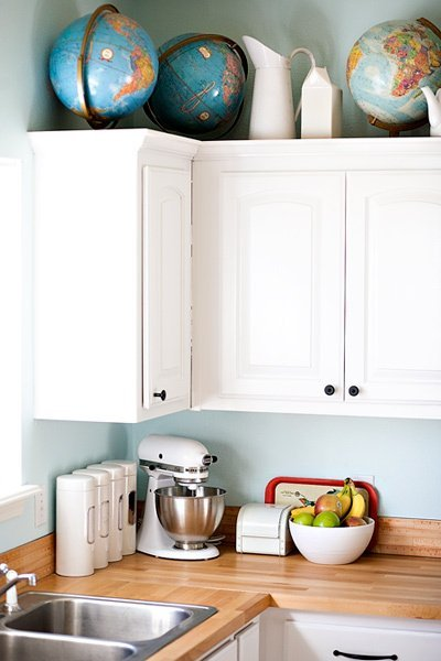 I never would have though of this in a million years, but antique rulers as a backsplash are really neat!  Image via Kitchn