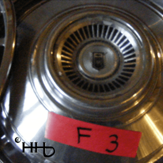 close up view of hubcap # c13chev1975_3