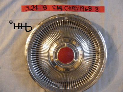 front view of hubcap # c14chry1968_3