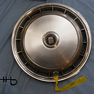 front view of hubcap # c15chry1977_2