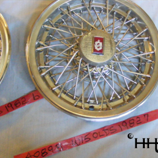 This hubcap is a wire wheel type hubcap # w15olds1982_7