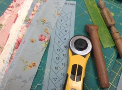Equipment, fabric, photo stated friendship braid pattern, rotary cutter, seam pressed, quarter inch ruler and rotary cutting board.