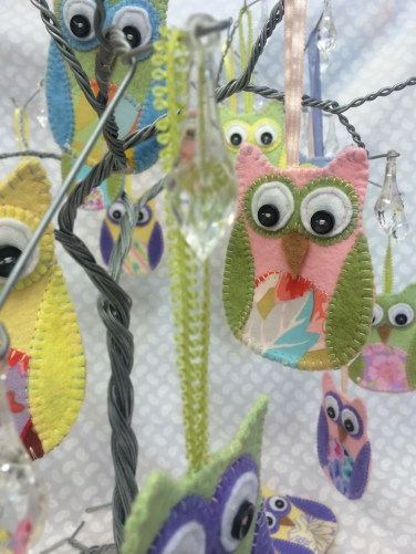 Owl hangings made from felt.