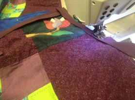 Sewing a binding on a quilt for a friend!