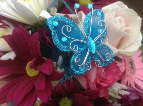 Flowers with a blue butterfly