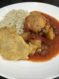 Buzymum - Chicken, tomato and borlotti bean stew served with rice and chicken skin crisps