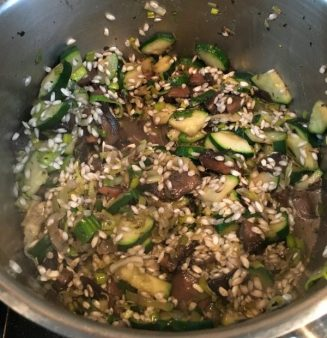 Buzymum - Risotto rice stirred into the mushroom and courgette