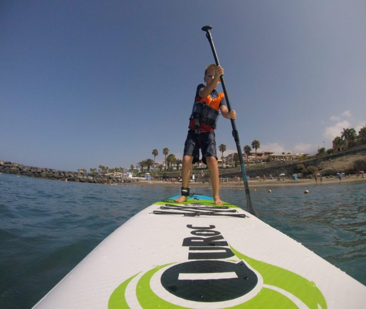 7 year old boy paddle boarding in Tenerife