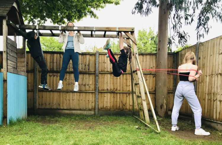 Buzymum- family using a climbing frame for fitness