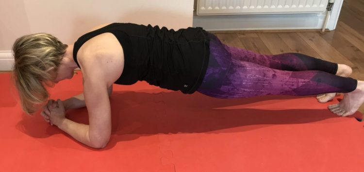 Showing a plank position