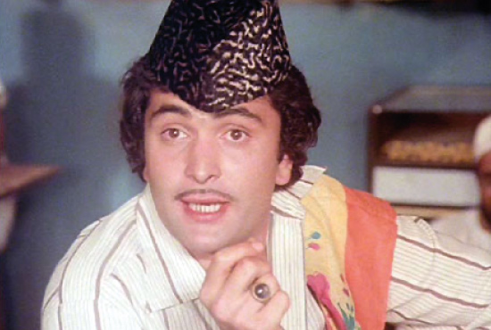 Akbar Illhabadi in Amar Akbar Anthony (1977)