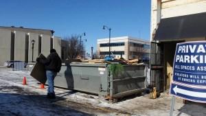 filling the dumpster