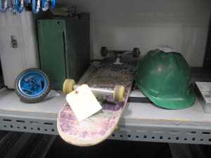 Skateboard, hard hat, blue wheel thing. If any of this is yours, get in touch!