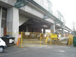 The chain-link fence under the station has been removed, as well as the TransLink garbage and recycling bins.