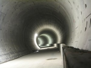 The rail tunnel curves under False Creek.