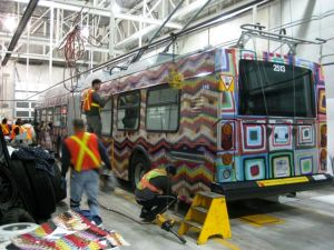 The Blanket Bus being wrapped with its afghan patterns.
