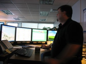 Duty manager Tony Madrid stands at the manager's desk, in the back of the T-Comm centre. Each supervisor has a row of screens like this displaying data from TMAC and more.